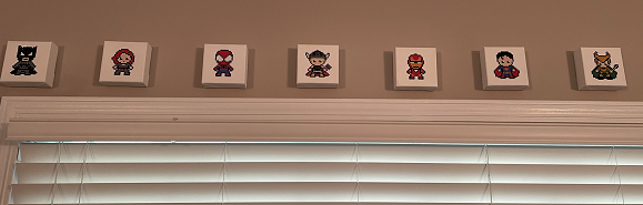 Marvel Diamond Art Stickers on Canvases hanging on a wall above a window