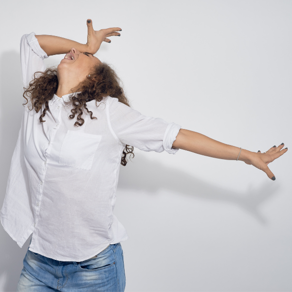 girl in dramatic pose with hand on head