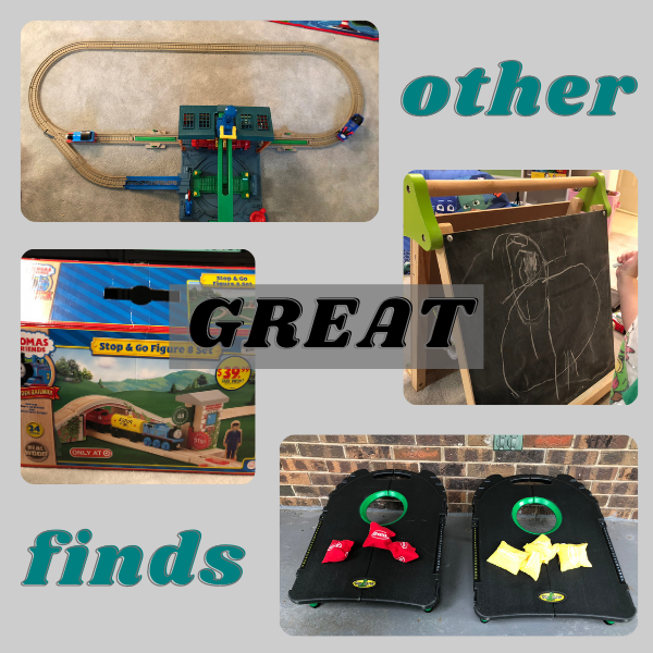 toy train tracks, chalkboard, and cornhole game from yard sales