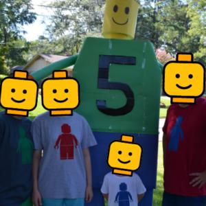Family wearing DIY LEGO man t-shirts at birthday party