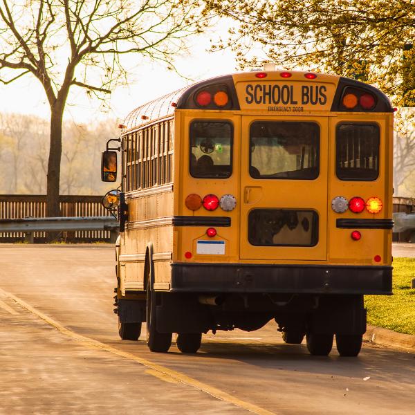 School Bus traveling on road